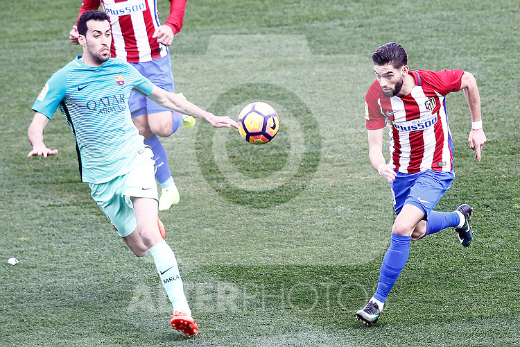 Atletico de Madrid's Yannick Ferreira Carrasco (r) and FC Barcelona's Sergio Busquets during La Liga match. February 26,2017. (ALTERPHOTOS/Acero)