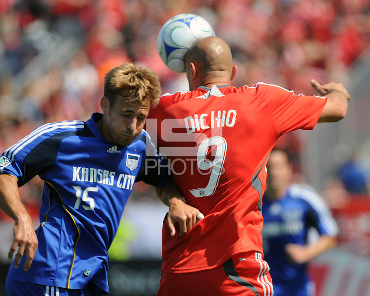 Danny Dichio (9) of Toronto FC gets a head on the ball before Aaron Hohlbein (15) could make contact. Toronto FC 0, Kansas City Wizards 0, BMO Field, Toronto, June 21, 2008.,