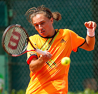 ALEXANDR DOLGOPOLOV (UKR) (21) against RAINER SCHUETTLER (GER) in the first round of the men's singles. Alexandr Dolgopolov beat Rainer Schuettler 6-3 6-3 6-1..Tennis - Grand Slam - French Open - Roland Garros - Paris - Day 3 -  Tue May 24th 2011..© AMN Images, Barry House, 20-22 Worple Road, London, SW19 4DH, UK..+44 208 947 0100.www.amnimages.photoshelter.com.www.advantagemedianetwork.com.