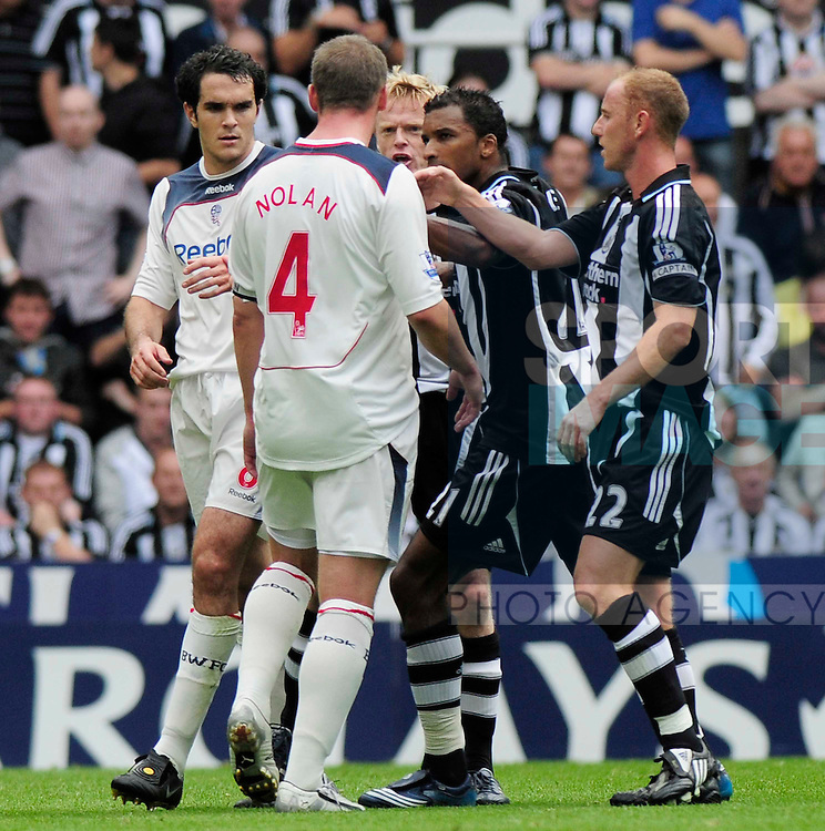 Newcastle's players confront Bolton's Kevin Nolan after Jonas Gutierrez is brought down after a bad tackle.
