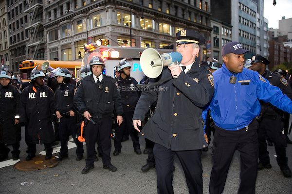"""Police stop students, workers, and other Occupy Wall Street supporters marching from Union Square Park on 5th Ave and 14th St on the two month anniversary of Occupy Wall Street, which the movement has dubbed it's """"Day of Action"""" in New York City, New York on 17 November 2011."""