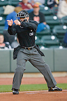 Home plate umpire Shaylor Smith makes a strike call during a Carolina League game between the Frederick Keys and the Winston-Salem Dash at  BB&T Ballpark April 28, 2010, in Winston-Salem, North Carolina.  Photo by Brian Westerholt / Four Seam Images