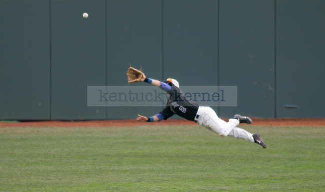 UK outfielder Zac Zellers leaps and catches a hit during the final game of the UK vs. South Carolina series in Lexington, Ky., on 3/18/12. Photo by Brandon Goodwin | Staff