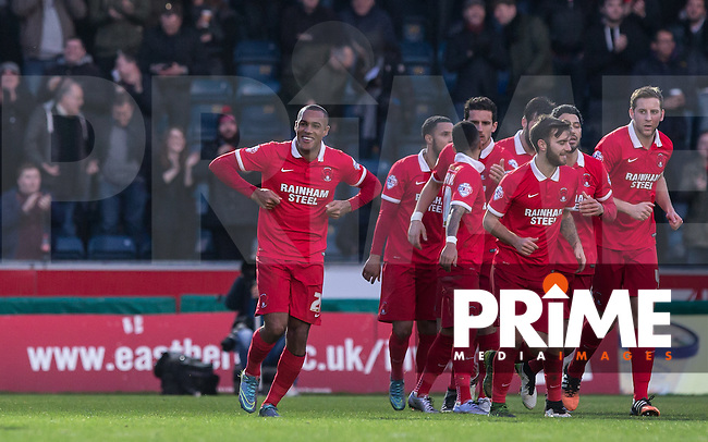 Goal scorer Jay Simpson of Leyton Orient does a chicken celebrations to Player Manager Kevin Nolan and the bench during the Sky Bet League 2 match between Wycombe Wanderers and Leyton Orient at Adams Park, High Wycombe, England on 23 January 2016. Photo by Andy Rowland / PRiME Media Images.