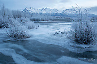 Winter landscape of frozen Knik River and frost-covered trees with Chugach Mountains at sunrise<br /> <br /> Photo by Jeff Schultz/SchultzPhoto.com  (C) 2018  ALL RIGHTS RESERVED