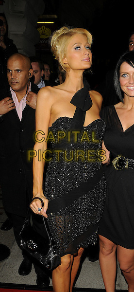 PARIS HILTON .outside Cuckoo Club, Swallow Street, London, England.9th October 2008.half 3/4 length black dress.CAP/CAN.©Can Nguyen/Capital Pictures
