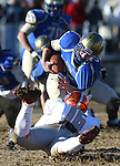 Bishop Gorman's Haskell Garrett sacks Reed quarterback Matt Denn in an NIAA Division I playoff game at Reed High School in Sparks, Nev., on Saturday, Nov. 28, 2015. Bishop Gorman won 41-13. (Cathleen Allison/Las Vegas Review-Journal)