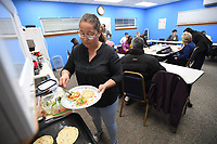 NWA Democrat-Gazette/J.T. WAMPLER Gaby Simental from Mexico makes sopes Wednesday Dec. 4, 2019 at the Ozark Literacy Council's holiday party. The organization has 400 adult students from 50 countries.