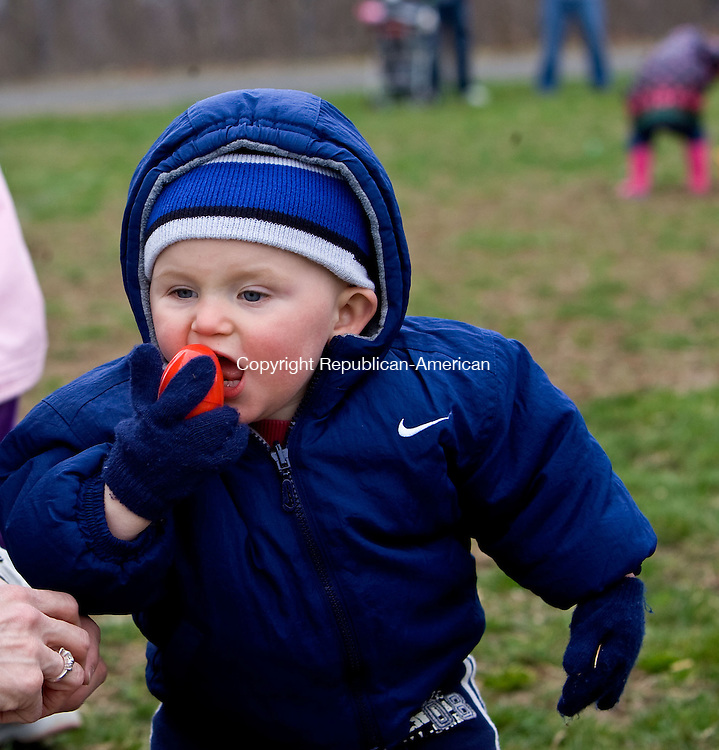 OXFORD, CT - 04 APRIL 2009 -040409JT05-<br /> FOR COUNTRY LIFE: Cole O'Connell, 14 months, spends his first Easter Egg Hunt trying to eat a plastic egg during the Easter Egg Hunt at Great Oak School in Oxford on Saturday, April 4, put on by the Oxford Parks and Recreation department. <br /> Josalee Thrift Republican-American