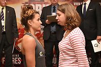 Chantelle Cameron (L) and Bilitis Gaucher during a Cyclone Promotions Weigh-In at the Grosvenor House Hotel on 6th October 2017