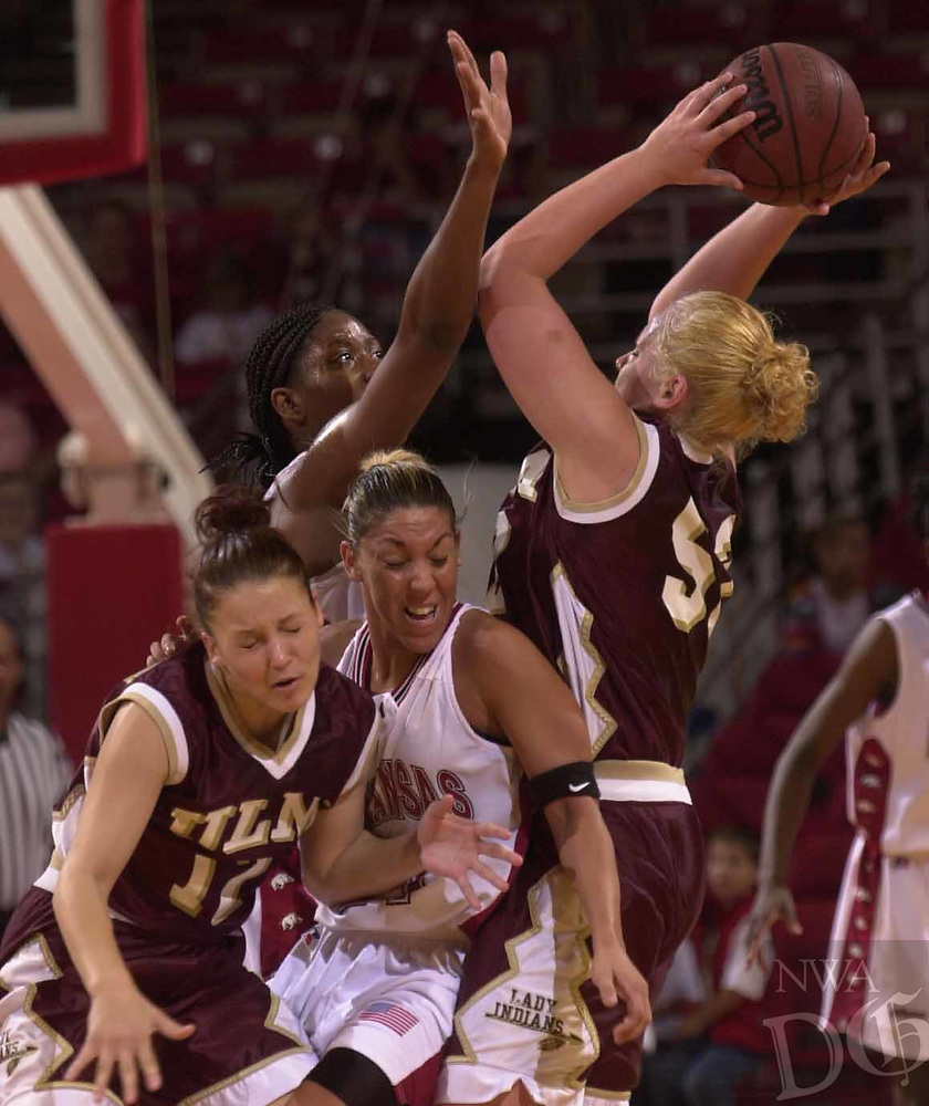 Arkansas Democrat-Gazette/LORI McELROY<br /><br />Arkansas Ladyback India Lewis is called for a foul against Louisiana Monroe Amy Faust. Trying to block Faust shot is Ladyback Cara Wright, bumping into Lewis is Stephanie Williams during the first half.<br /><br />11-17-01
