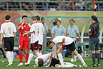 10 August 2008: Referee Hector Baldassi (ARG) (right) shows a red card to Zheng Zhi (CHN) (8).  The men's Olympic soccer team of Belgium defeated the men's Olympic soccer team of China 2-0 at Shenyang Olympic Sports Center Wulihe Stadium in Shenyang, China in a Group C round-robin match in the Men's Olympic Football competition.