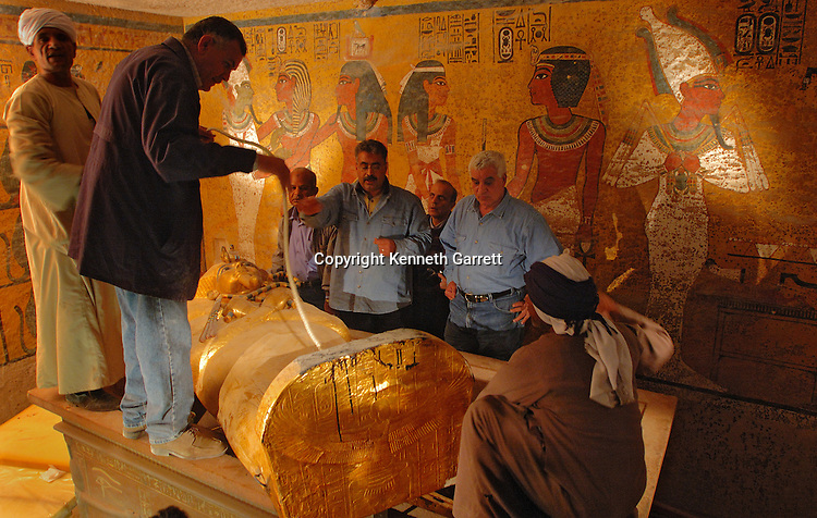 Interior of tomb KV62, Dr. Zahi Hawass and all Egyptian research team remove coffin, Tutankhamun and the Golden Age of the Pharaohs; Page 260-261