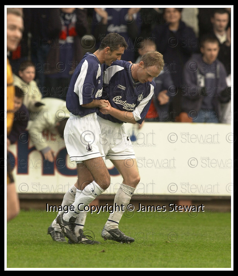9/11/02       Copyright Pic : James Stewart                     .File Name : stewart-falkirk v alloa 10.JOHN HENRY IS CONGRATULATED BY OWEN COYLE AFTER SCORING THE FIRST...James Stewart Photo Agency, 19 Carronlea Drive, Falkirk. FK2 8DN      Vat Reg No. 607 6932 25.Office : +44 (0)1324 570906     .Mobile : + 44 (0)7721 416997.Fax     :  +44 (0)1324 570906.E-mail : jim@jspa.co.uk.If you require further information then contact Jim Stewart on any of the numbers above.........