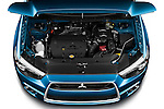 Hood and engine compartment high angle view of a 2011 Mitsubishi Outlander Sport SE. Use as a single frame or part of a four frame animations sequence.