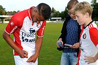 SCHOONEBEEK - Voetbal, SVV 04 - FC Emmen, voorbereiding seizoen 2018-2019, 06-07-2018,  FC Emmen speler Luciano Slagveer deelt handtekeningen uit