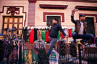 EGYPT / Cairo / 27.11.2012 / Street sellers look at protesters during a march from the Shubra neighbourhood to Tahrir square, where thousands of people have gathered to protest President Morsi's above-the-law constitutional declaration © Giulia Marchi