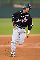 Danny Bomback (13) of the Hickory Crawdads hustles towards third base versus the Kannapolis Intimidators at Fieldcrest Cannon Stadium in Kannapolis, NC, Saturday, April 12, 2008.