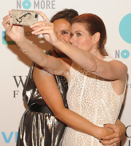 New York,NY-May 29: Mariska Hargitay and Debra Messing Attends Mariska Hargitayís Joyful Heart Foundation 10th anniversary  in New York City on May 29, 2014. Credit: John Palmer/MediaPunch