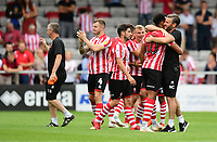 Lincoln City's assistant manager Nicky Cowley, right, hugs Lincoln City's Matt Green at the end of the game<br /> <br /> Photographer Chris Vaughan/CameraSport<br /> <br /> The EFL Sky Bet League Two - Lincoln City v Swindon Town - Saturday 11th August 2018 - Sincil Bank - Lincoln<br /> <br /> World Copyright &copy; 2018 CameraSport. All rights reserved. 43 Linden Ave. Countesthorpe. Leicester. England. LE8 5PG - Tel: +44 (0) 116 277 4147 - admin@camerasport.com - www.camerasport.com