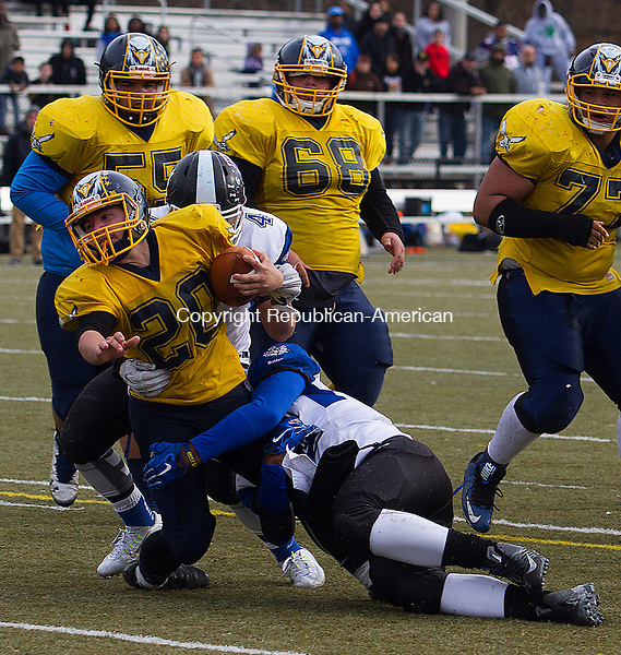 WATERURY, CT - 26 NOVEMBER 2015 -112615JW11.jpg -- Kennedy #20 Jacob Colonis tackled by Crosby #4 Devonte Detanto and #12 Mike Marshall during the Thanksgiving Day 2015 Brass Division and City Championship game at Ray Snyder Sr. Field Thursday morning. Crosby won 18-15.  Jonathan Wilcox Republican-American
