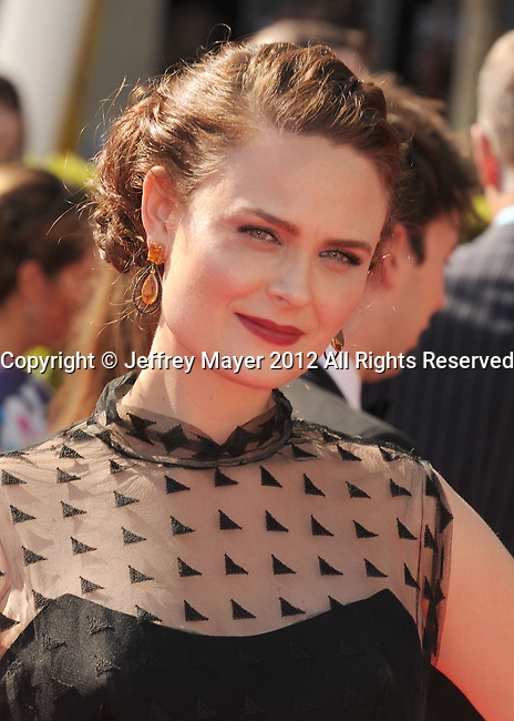 LOS ANGELES, CA - SEPTEMBER 15: Emily Deschanel arrives at the 2012 Primetime Creative Arts Emmy Awards at Nokia Theatre L.A. Live on September 15, 2012 in Los Angeles, California.