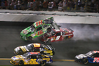 The cars of Kyle Busch (18) and Kasey Kahne (9) collide at the end of the Coke Zero 400, Daytona International Speedway, Daytona Beach, FL, July 4, 2009.  (Photo by Brian Cleary/www.bcpix.com)