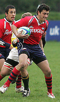 Chile full back Tomas Smits makes a break in the match for 7th place against Zimbabwe during the 7th place play-off in Division B of the Under 19 Rugby World Championship at Gibson Park Malone 2007.