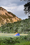 A tent in a meadow on a Smith River canoe trip in Montana