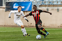 Maryland Terrapins midfielder Schillo Tshuma (23) is marked by Notre Dame Fighting Irish defender Max Lachowecki (6). The Notre Dame Fighting Irish defeated the Maryland Terrapins 2-1 during the championship match of the division 1 2013 NCAA  Men's Soccer College Cup at PPL Park in Chester, PA, on December 15, 2013.
