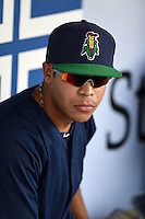 Cedar Rapids Kernels pitcher Josue Montanez (24) in the dugout before a game against the Quad Cities River Bandits on August 18, 2014 at Perfect Game Field at Veterans Memorial Stadium in Cedar Rapids, Iowa.  Cedar Rapids defeated Quad Cities 4-2.  (Mike Janes/Four Seam Images)