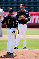 Kris Gardner (13) of the Wichita State Shockers stands on the mound during a game against the Missouri State Bears in the 2012 Missouri Valley Conference Championship Tournament at Hammons Field on May 23, 2012 in Springfield, Missouri. (David Welker/Four Seam Images)