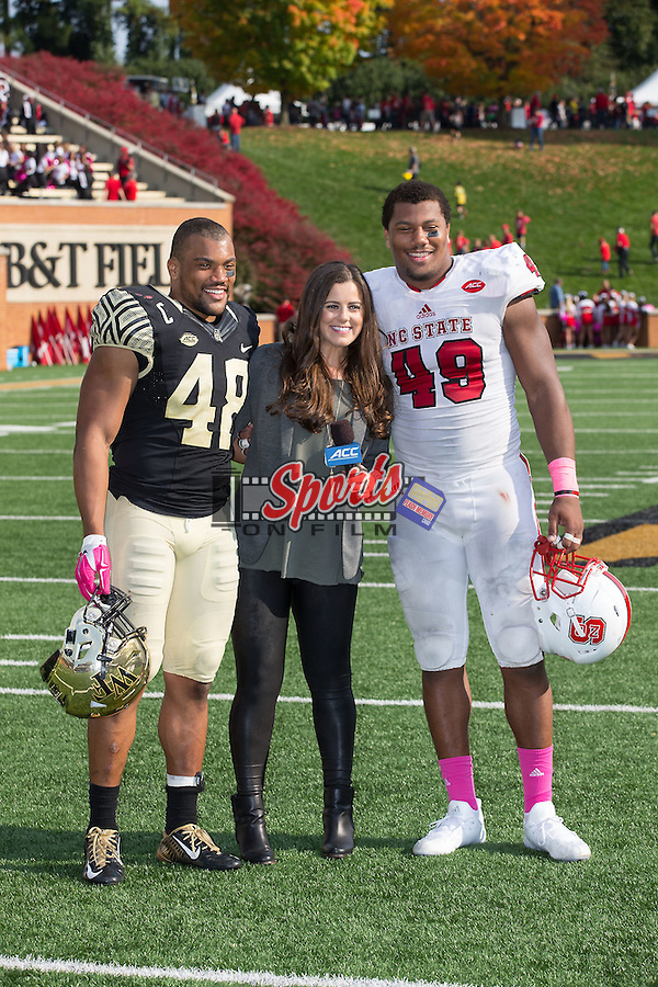 Brothers Brandon Chubb (48) of the Wake Forest Demon Deacons and Bradley Chubb (49) of the North Carolina State Wolfpack pose for a photo with ACC sideline reporter Niki Noto Palmer following the football game at BB&T Field on October 24, 2015 in Winston-Salem, North Carolina.  The Wolfpack defeated the Demon Deacons 35-17.   (Brian Westerholt/Sports On Film)