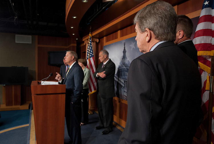 UNITED STATES - July 17: Bipartisan group of Senators Richard Bluenthal, D-CT., Lindsey Graham, R-SC., Amy Klobuchar, D-MN., Charles Schumer, D-NY., Roy Blunt, R-MO., and Jon Tester, D-MT., during a press conference on their support for an updated media shield bill that would codify the recently-announced Department of Justice guidelines into law. The group of senators will announce their support for Senator Charles E. Schumer's original media shield legislation, and also discuss possible additional provisions that would protect the First Amendment and assist law enforcement. (Photo By Douglas Graham/CQ Roll Call)