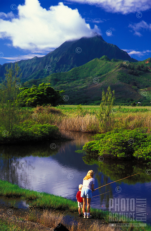 Mother and son fishing in Kawainui Marsh, Kailua, windward Oahu