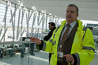 Mihaly Hardy communications manager of Budapest Airport talks about the work is in progress in the new Skycourt building at the Budapest Airport in Budapest, Hungary on March 08, 2011. ATTILA VOLGYI