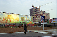 milano, periferia nord. dei cartelloni reclamizzano il nuovo quartiere in costruzione tra quarto oggiaro e certosa --- milan, north periphery. billboards for the new residential buildings compound that is under construction at quarto oggiaro - certosa district