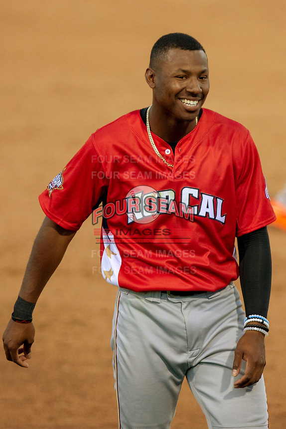 Kyle Lewis (1) of the Modesto Nuts smiles to the crowd during the 2018 California League All-Star Game at The Hangar on June 19, 2018 in Lancaster, California. The North All-Stars defeated the South All-Stars 8-1.  (Donn Parris/Four Seam Images)
