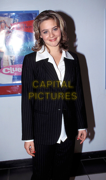 "ALICIA SILVERSTONE..""Clueless"" Premiere..Ref: 1618..smiling, black suit, white blouse, half length..sales@capitalpictures.com..www.capitalpictures.com..©Capital Pictures"