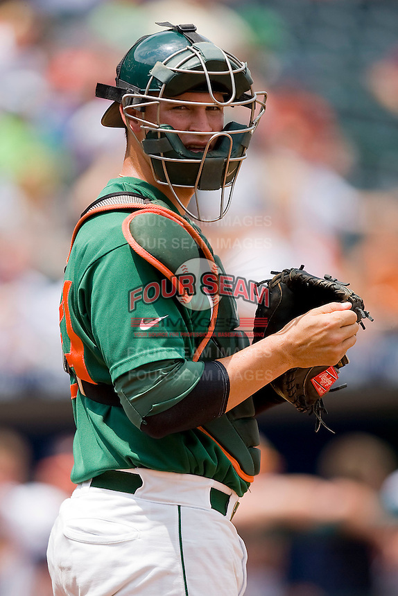 Catcher Yasmani Grandal #24 of the Miami Hurricanes looks to the dugout for a sign against the Virginia Cavaliers at the 2010 ACC Baseball Tournament at NewBridge Bank Park May 29, 2010, in Greensboro, North Carolina.  The Cavaliers defeated the Hurricanes 12-8.  Photo by Brian Westerholt / Four Seam Images