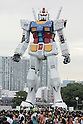 "A 1/1 scale RX78 Gundam erected in Odaiba for the 30th anniversary of the animated television series ""Mobile Suit Gundam"". The Gundam statue move its head and emit light or mist from 50 points. It will be displayed through Aug. 31"