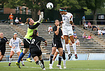 24 August 2012: Duke's Kim DeCesare (19) heads the ball over Montreal's Martine Julien (CAN) (26). The Duke University Blue Devils defeated the University of Montreal Caribins 4-1 at Fetzer Field in Chapel Hill, North Carolina in an international women's collegiate friendly game.
