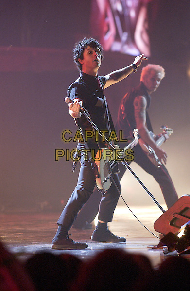 GREEN DAY - BILLIE JOE ARMSTRONG.Brit Awards 2005.Earls Court 2, London, SW5.February 9th, 2005.full length, stage concert live gig music guitar microphone.www.capitalpictures.com.sales@capitalpictures.com.©Capital Pictures