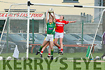 Laura Rogers Kerry fields the ball under the Cork bar despite the pressure from Jess O'Shea Cork during their clash in the TG4 Munster Senior Championship in Macroom on Friday evening