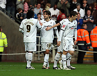 ATTENTION SPORTS PICTURE DESK<br /> Pictured: Jordi Gomez of Swansea (C) celebrating his goal with team mates and fellow double scorer Jason Scotland (L).<br /> Re: Coca Cola Championship, Swansea City FC v Doncaster Rovers at the Liberty Stadium. Swansea, south Wales, Saturday 21 February 2009<br /> Picture by D Legakis Photography / Athena Picture Agency, Swansea 07815441513