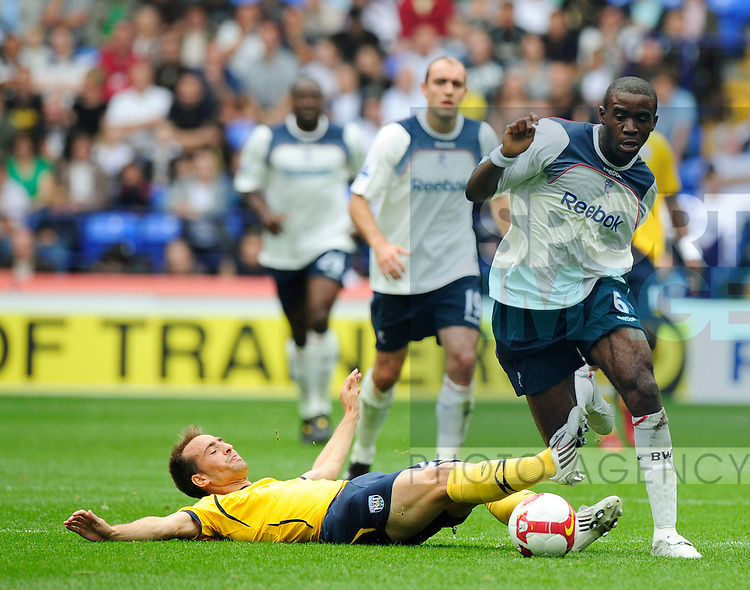 Fabrice Muamba of Bolton skips past the tackle of Borja Valero of West Bromwich Albion