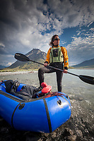 Ali blechman and pack raft, Marsh Fork of the Canning River in the Arctic National Wildlife Refuge, Brooks Range mountains, Alaska.