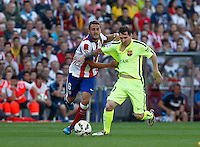 FC Barcelona´s Argentinean forward Lionel Messi and Atletico Madrid´s Koke