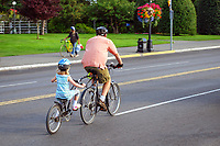 Cyclists, adult, child, tandem, cycling, bicycling, downtown, Victoria, British Columbia, Canada, 200809081086<br />