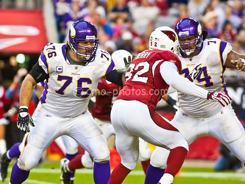 Dec 14, 2008; Glendale, AZ, USA; Minnesota Vikings offensive guard Steve Hutchinson (76) and offensive tackle Bryant McKinnie (74) block  Arizona Cardinals defensive end Bertrand Berry (92) in the fourth quarter of a game at University of Phoenix Stadium.  The Vikings won the game 35-14.